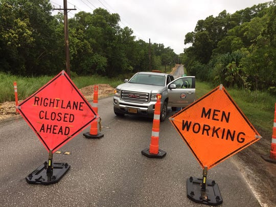 Road closure signs are shown on Cross island road along Cross island road due to  a fallen power pole on July 5, 2018.