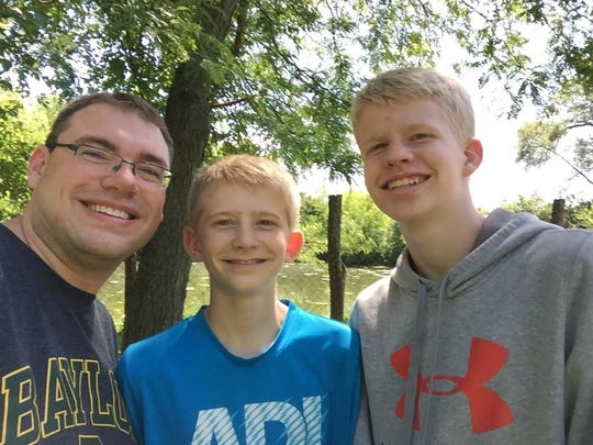 Zachary Hyde, middle, smiles with Daniel Pierce, left, and his older brother, Samuel. Hyde, 14, died July 6 from injuries sustained in a recent car crash.