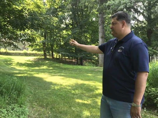 Woodcliff Lake Mayor Carlos Rendo shows where 16 affordable housing units will be built along Broadway.