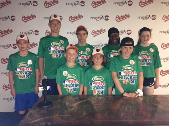 Gavin McIntyre poses for a pictures with other members of the Scott MLB Pitch, Hit & Run competition at Camden Yards.