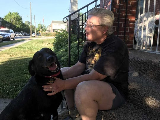 Andrea Roth pets her hero, her 13-year-old black lab,