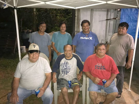 Jose F Blas Jr., third from left in back wearing blue shirt, with family members.