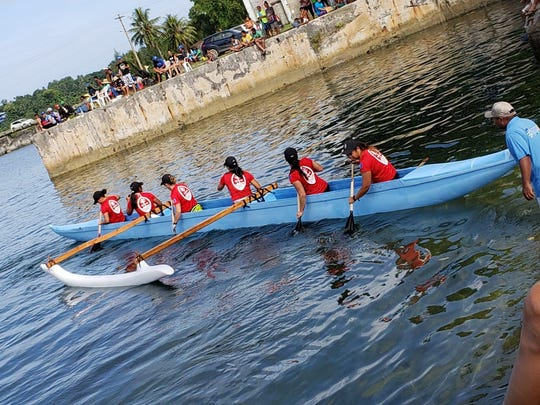 Guam's women paddlers get set before the finals of their sprint race on July 18 at the Micronesian Games in Yap. The lady paddlers took a silver in the 1,500 and bronze in the 500, while Guam's men won silver in the 500 and bronze in the 1,500.