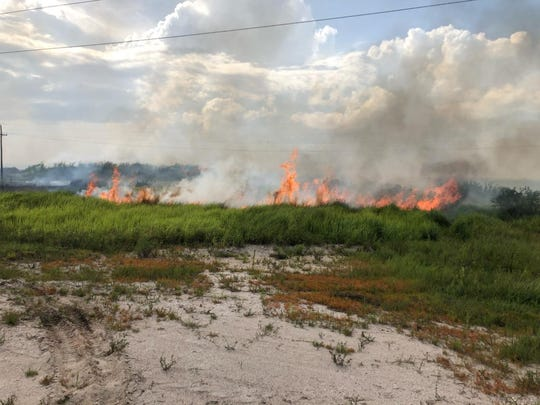 A 20-acre wildfire burned for several hours in Indiantown earlier this year. Florida Forest Service officials are urging people to use caution this 4th of July when handling fireworks and flames.