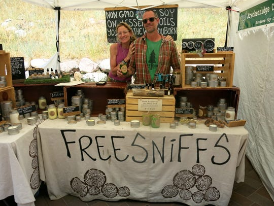 Breckenridge Candle Cabin candlemaker Christopher Simoni (right) and his sister Cheryl  Ryba  show the soy candles at the Vail Market booth, which has so much personality that it always attracts crowds.