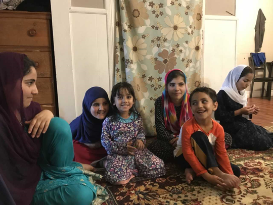 Naseema Zadran, 11, third from right, with other members of the Zadran family who fled war in their native Afghanistan and settled in Albany. A Nyack resident and a friend who works in Westchester are arranging to have new shoes delivered to them and other Afghan refugees.