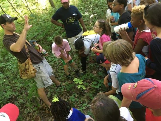 Matt Shull of White Pine Wilderness Academy teaches Earth Charter Indiana's Climate Campers about edible plants. Afterwards, Keep Indianapolis Beautiful taught campers about pollinator health, and they later performed pollinator counts in urban destinations around Indianapolis.