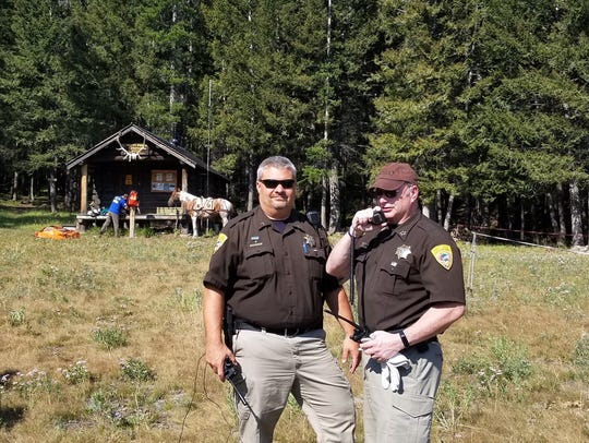 Lewis and Clark County Sheriff Leo Dutton communicates