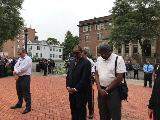 Heads bowed for a moment of silence marking the time the second plane struck the Twin Towers at Plainfield Sept. 11 remembrance ceremony.