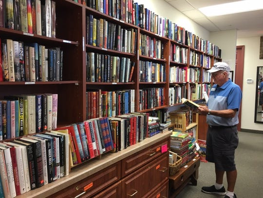 Fiction alphabetized by author makes it easy to find