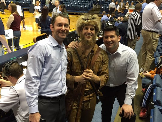 The West Virginia Mountaineer poses with Monmouth University radio duo Steve Bazaz (left) and Eddy Occhipinti.