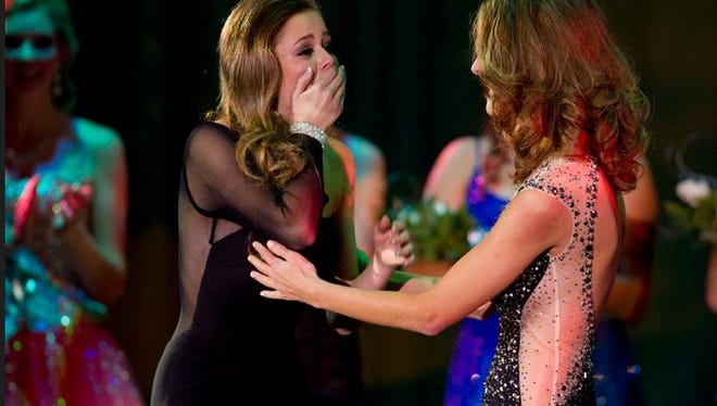 Madeline Kumm, left, reacts after being announced as the 2015 Miss Wisconsin Rapids Area as runner-up Hannah Ashbeck, right, watches Oct. 25 during the Miss Wisconsin Rapids Area Scholarship Pageant at the Performing Arts Center.
