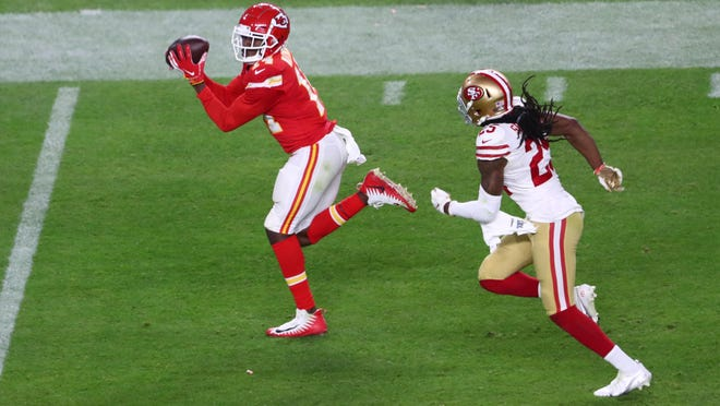Kansas City Chiefs wide receiver Sammy Watkins, left, races past San Francisco 49ers cornerback Richard Sherman to haul in a pass from Patrick Mahomes in Super Bowl LIV. The play helped the Chiefs score the go-ahead touchdown on the way to a 31-20 victory.