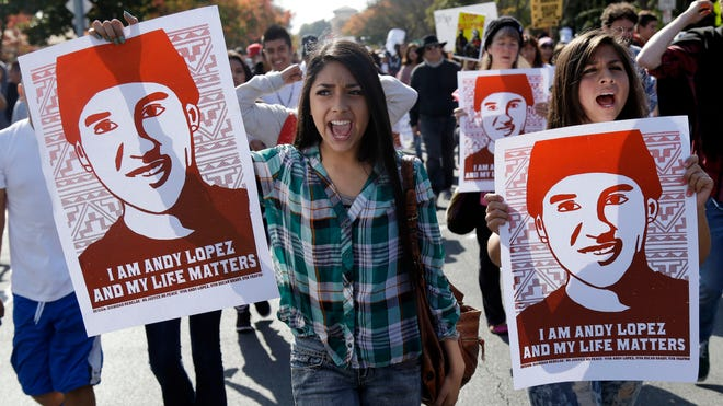 Protesters carried an image of Andy Lopez as they marched Oct. 29, 2013, in Santa Rosa, Calif.