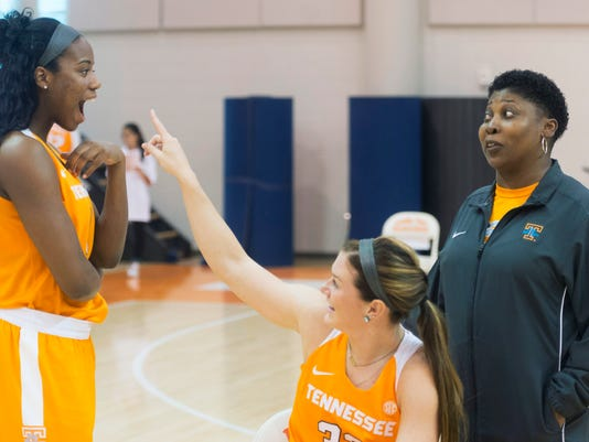 Tennessee players Jordan Reynolds, left, Alexa Middleton, and assistant coach Jolette Law gestures during NCAA college basketball media day, Tuesday, Oct. 27, 2015, in Knoxville, Tenn. (Saul Young/Knoxville News Sentinel via AP) MANDATORY CREDIT