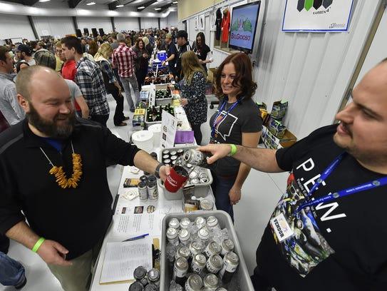Corey Weinkoetz of MobCraft Beer, Milwaukee, pours