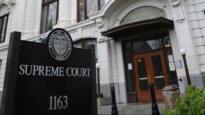 The Oregon Supreme Court building on State Street in Salem on a cold and rainy day on Thursday, Dec. 20, 2012.
