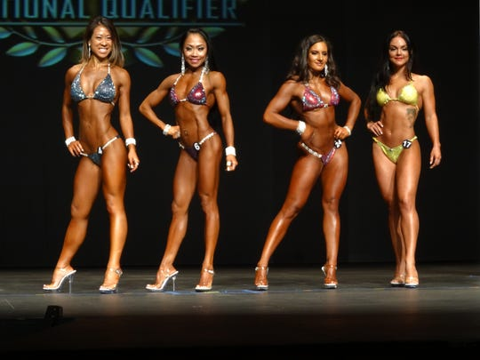 Rhea Macaluso, second from left, finished fourth at the National Physique Committee New Jersey State Championships on Aug. 20.