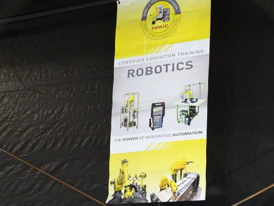 Fanuc banners hang in the RAMTEC center to show come