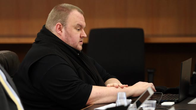 Megaupload founder Kim Dotcom sits in court in Auckland on Sept. 21, 2015, as he fights a U.S. bid to extradite him from New Zealand.
