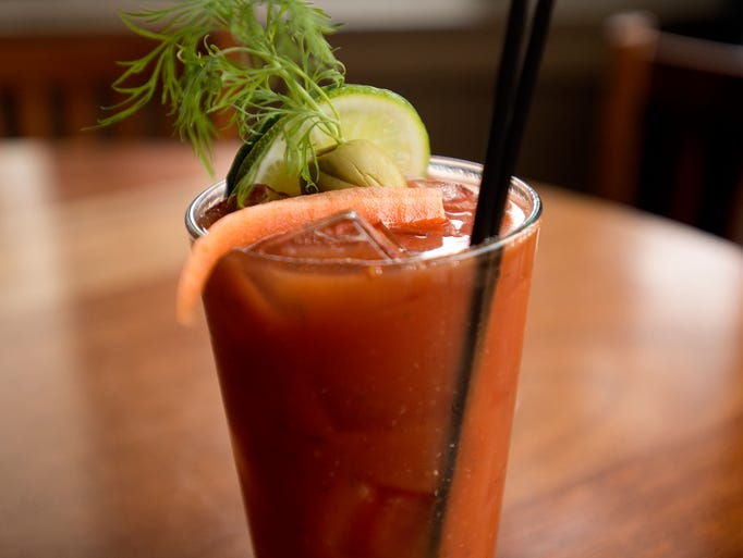 Cafe Vino's Garden Bloody Mary uses house-infused carrot vodka as seen here Saturday, March 22, 2014.