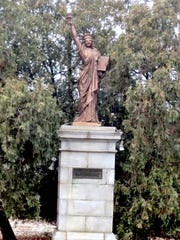 The eight and half-foot high version of the Statue of Liberty, now on the island in Kiwanis Lake, was created in 1951.