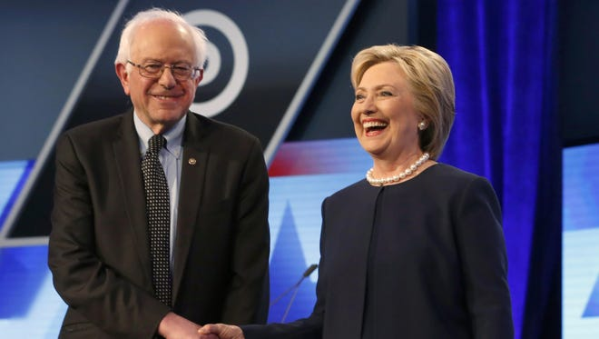 Democratic presidential candidates Hillary Clinton and Sen. Bernie Sanders, I-Vt, shake hands before the start of the a Democratic presidential debate March 9 in Miami, Florida.