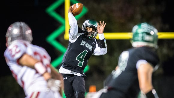 East Henderson's Chris Hemphill makes a pass during