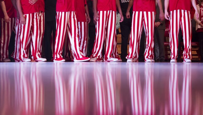 Indiana players watch a video before player introductions during a NCAA men's basketball game on Saturday, Dec. 6, 2014, at Assembly Hall in Bloomington. (James Brosher / For The Star)