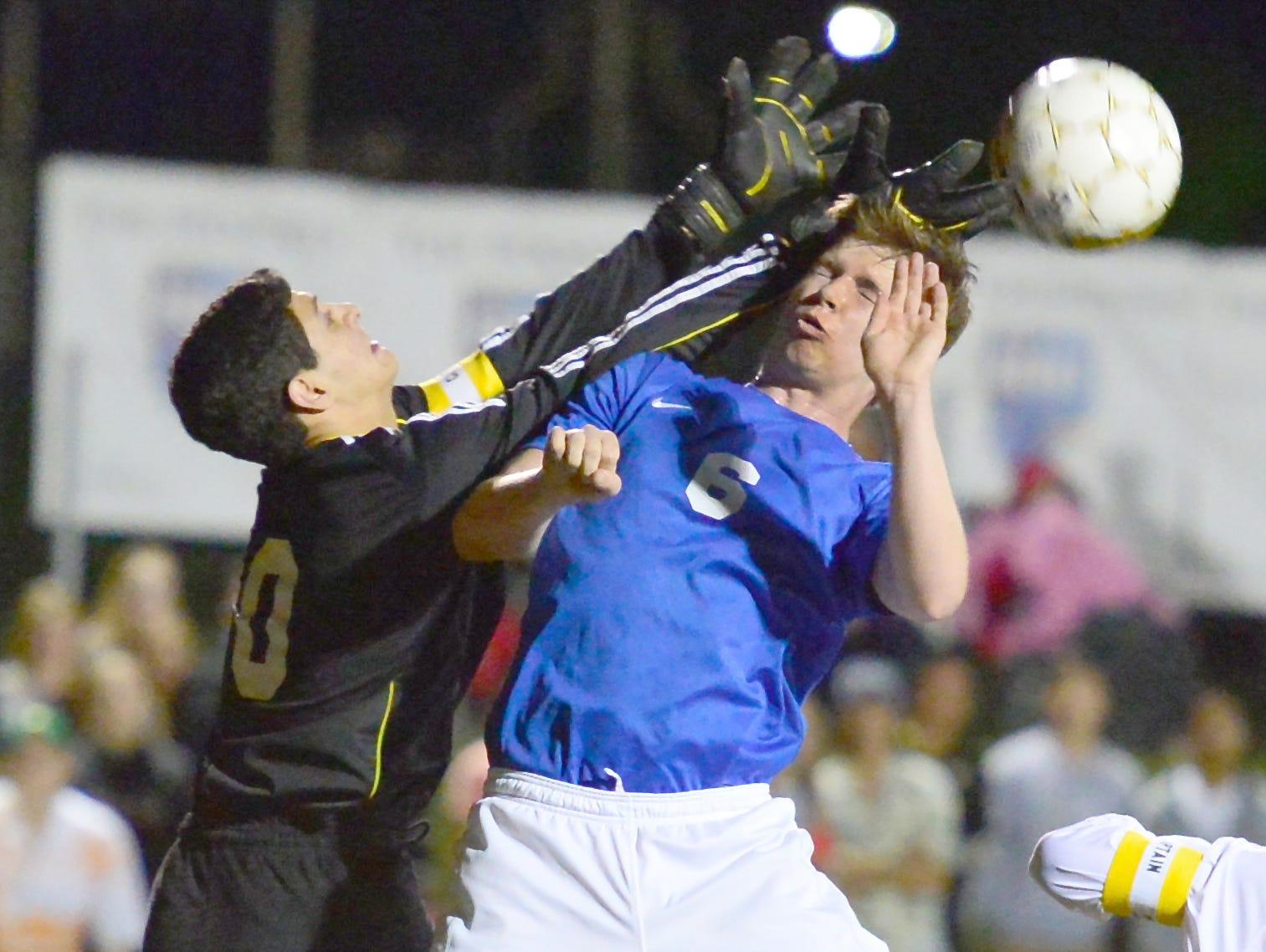 Merrol Hyde Magnet senior goalkeeper Nicholas Goldberg makes a save as he collides with White House junior forward Josh Dunlap during second-half action.
