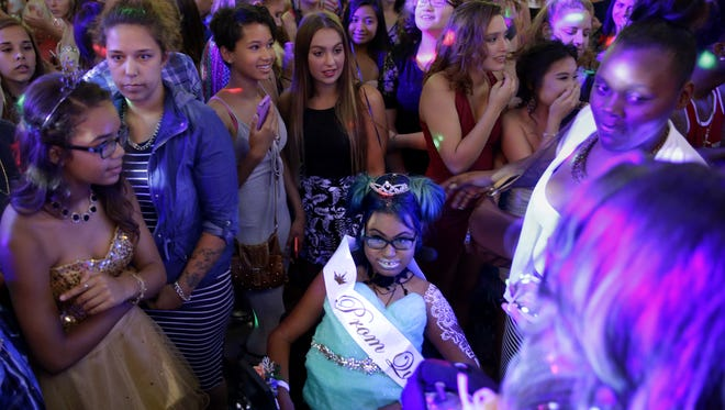 Jerika Bolen is surrounded by a sea of guests at her prom Friday  at the Grand Meridian in Appleton, Wis. The ballroom was packed for the five-hour dance in celebration of Jerika.