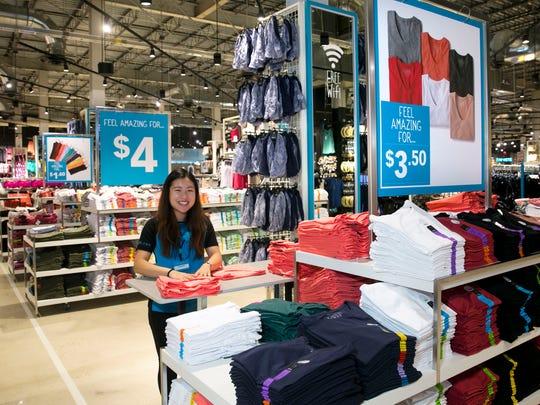 Samantha Foo, a sales associate, gets clothing displays