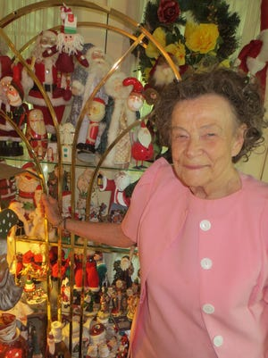 Annabelle (Ann) DeHoff with just a small part of her year round Santa collection at her home.