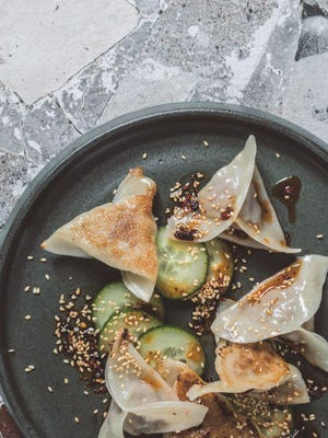 Making dumplings is a relatively simple process, but it can feel laborious when you're making a large quantity, which is why many families often share the task. Lotus Chinese owner Gary Wu remembers making hundreds of dumplings with his family on Sunday afternoons when he was a kid growing up outside New York City.