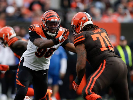 Cincinnati Bengals defensive end Carlos Dunlap (96) plays against Cleveland Browns offensive tackle Kendall Lamm (70) during the first half of an NFL football game, Sunday, Dec. 8, 2019, in Cleveland. (AP Photo/Ron Schwane)