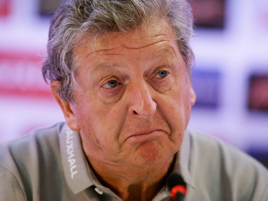 England national soccer team head coach Roy Hodgson pulls an expression as he speaks during a press conference after a squad training session that was closed to the media for the 2014 soccer World Cup at the Urca military base in Rio de Janeiro, Brazil, Sunday, June 22, 2014.  Costa Rica's surprise 1-0 win over Italy on Friday meant that England made its most humiliating exit from a World Cup since 1958, following consecutive defeats by the Italians and then Uruguay in Group D.  England play Costa Rica in their final Group D match on Tuesday.  (AP Photo/Matt Dunham)