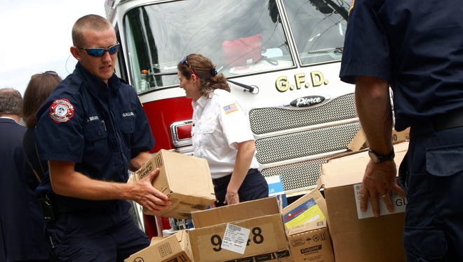 Gallatin firefighter Justin Brannon helps deliver toiletry items to the Family Resources Center for Sumner County Schools, which were collected during the Gallatin Fire Department's toiletry drive in 2016.