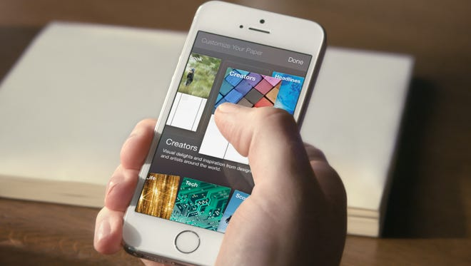 The app Paper appears on an iPhone 5S.
