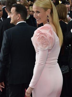 Gwyneth Paltrow walks behind her longtime publicist, Stephen Huvane.