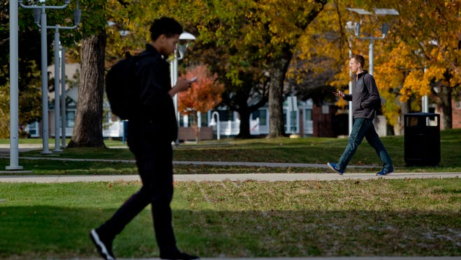 Students walk to class Thursday, October 22, 2015 on the campus of St. Clair County Community College in Port Huron.