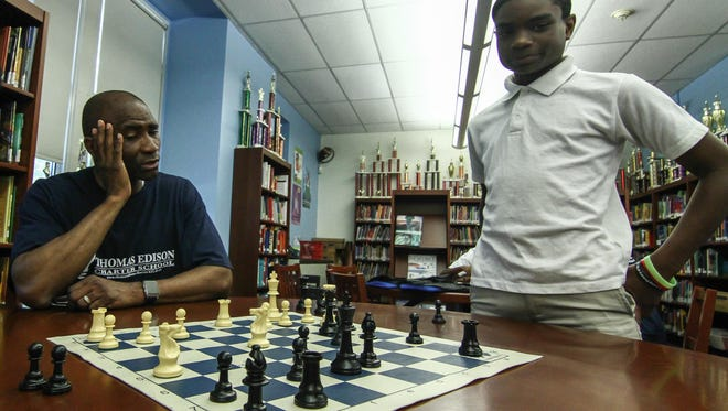 Principal Salome Thomas-EL, left, discuss possible moves of the pieces with Mark Coney (13), right, during a after school chess session Wednesday, June. 1, 2016 at Thomas Edison Charter School in Wilmington. The school has received an grant for its Chess, Health, Arts, Math and Parent Enrichment or CHAMP program.
