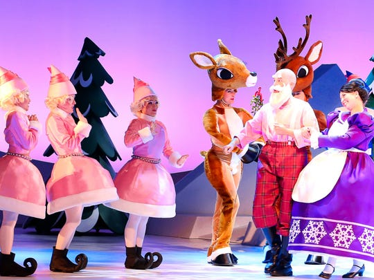 """Rudolph chats with the Clauses and some of their elves in """"Rudolph, the Musical."""""""