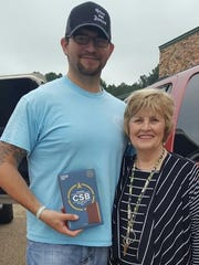 Luke Hockenjos and Connie Eagles following a Bible donation.