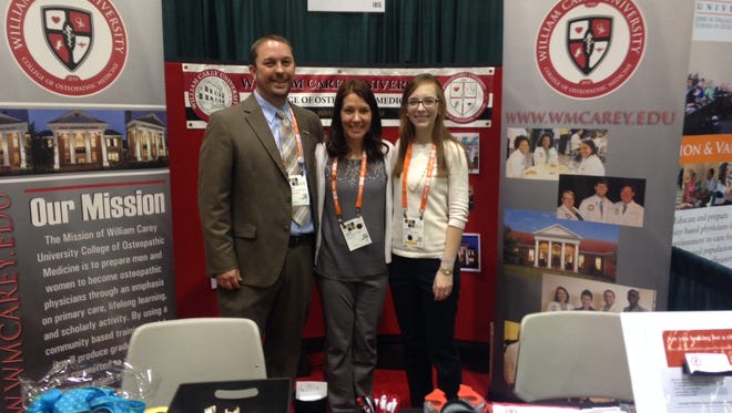 Representing the William Carey University College of Osteopathic Medicine at the recent Osteopathic Medical Conference and Exposition in Seattle were (from left to right) Student Doctors David Buford, a second-year student from Hattiesburg; Jamie Bishop, a fourth-year student from Prattville, Ala.; and Alexis Cates, a fourth-year student from Mandeville, La. The conference, the premier educational event for the osteopathic medical profession, brings together more than 5,000 physicians and osteopathic medical students from around the United States.