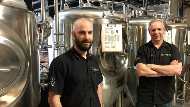 Owners of Final Draft Brewing Company, Bart Hauptman (left) and Adam Ward, stand in front of fermenters at Final Draft in downtown Redding.