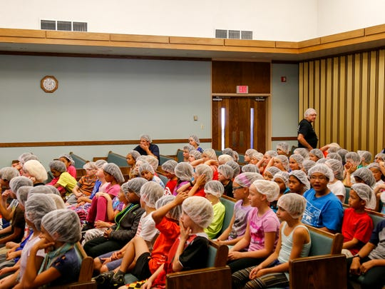 Belle Sherman students await instructions for the Feed My Starving Children event on Thursday afternoon.