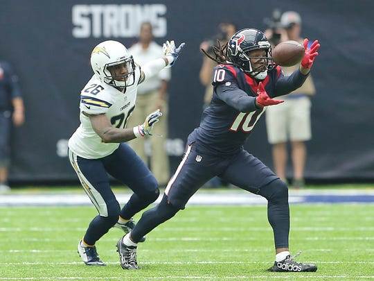 Houston Texans wide receiver DeAndre Hopkins (10) makes a catch against San Diego Chargers cornerback Casey Hayward (26) in the first quarter at NRG Stadium.