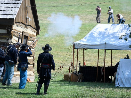 "Union troops defending Newburgh and Confederate raiders led by Adam R. ""Stovepipe"" Johnson exchange fire during a reenactment of Johnson's raid at the ""Newburgh Remembers"" event Sunday, July 16, 2017."