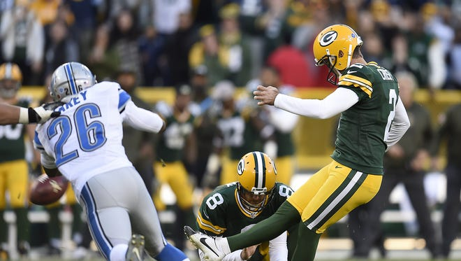 Green Bay Packers kicker Mason Crosby tries to hit a 52-yard field goal to win the game against the Detroit Lions during Sunday's game at Lambeau Field. Crosby missed the field goal. The Lions went on to defeat the Packers 18-16.