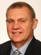 Ithaca College men's basketball coach Jim Mullins.